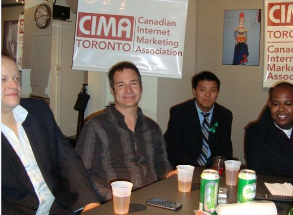 Rob Campbell surrounded by members of CIMA Toronto