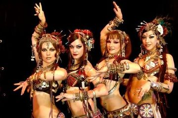 Photograph of belly dancers.